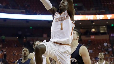 """<p>               FILE - In this Nov. 14, 2017, file photo, Texas guard Andrew Jones (1) drives to the basket past New Hampshire forward Tanner Leissner (21) during the second half of an NCAA college basketball game, in Austin, Texas. Jones is ready for """"significant"""" playing time after missing most of the last two seasons for cancer treatment, Longhorns coach Shaka Smart said Monday, Nov. 4, 2019. (AP Photo/Eric Gay, File)             </p>"""