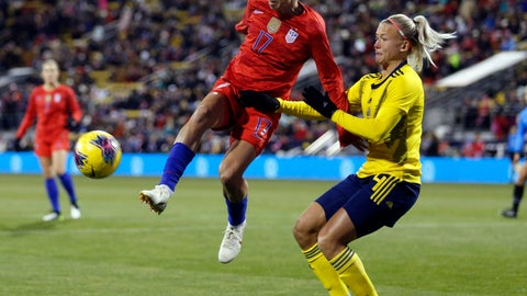 <p>               United States forward Tobin Heath, left, passes the ball in front of Sweden defender Hanna Glas during the first half of a women's international friendly soccer match in Columbus, Ohio, Thursday, Nov. 7, 2019. (AP Photo/Paul Vernon)             </p>