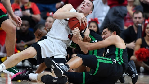 <p>               Louisville guard Ryan McMahon, left, battles South Carolina Upstate guard Josh Aldrich, right, for a loose ball during the first half of an NCAA college basketball game in Louisville, Ky., Wednesday, Nov. 20, 2019. (AP Photo/Timothy D. Easley)             </p>