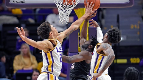 <p>               LSU forward Courtese Cooper (21) blocks the shot of Nicholls guard Andre Jones (13), center, as teammate Charles Manning Jr. (11), right, helps in the first half of an NCAA college basketball game, Saturday, Nov. 16, 2019, in Baton Rouge, La. (AP Photo/Bill Feig)             </p>