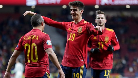 <p>               Spain's Gerard Moreno celebrates with Santi Carzola, left, after scoring his side's second goal during the Euro 2020 group F qualifying soccer match between Spain and Romania at the Metropolitano stadium in Madrid, Monday, Nov. 18, 2019. (AP Photo/Manu Fernandez)             </p>