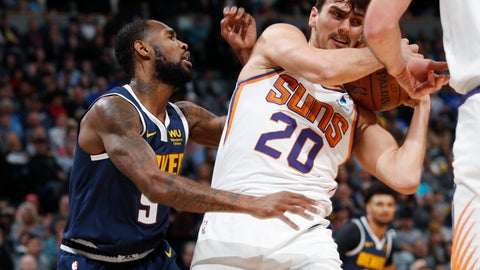 <p>               Phoenix Suns forward Dario Saric, right, pulls in a rebound as Denver Nuggets guard Will Barton defends in the first half of an NBA basketball game Sunday, Nov. 24, 2019, in Denver. (AP Photo/David Zalubowski)             </p>