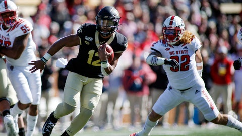 <p>               Wake Forest quarterback Jamie Newman (12) runs for a touchdown against North Carolina State in the first half an NCAA college football game in Winston-Salem, N.C., Saturday, Nov. 2, 2019. (AP Photo/Nell Redmond)             </p>