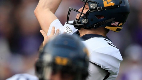 <p>               FILE - In this Nov. 16, 2019, file photo, West Virginia quarterback Jarret Doege passes during the first half of an NCAA college football game against Kansas State in Manhattan, Kan. Bowling Green transfer Jarret Doege delivered last week in his first start when West Virginia needed a spark at Kansas State to end a five-game losing streak.  Doege is expected to get the call again when the Mountaineers play in their home finale Saturday against No. 22 Oklahoma State. (AP Photo/Orlin Wagner, File)             </p>