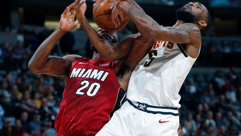 <p>               Denver Nuggets forward Will Barton, right, fights for control of a rebound with Miami Heat forward Justise Winslow in the first half of an NBA basketball game Tuesday, Nov. 5, 2019, in Denver. (AP Photo/David Zalubowski)             </p>