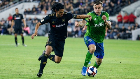 <p>               Los Angeles FC forward Carlos Vela, left, vies against Seattle Sounders forward Jordan Morris during the second half of the MLS soccer Western Conference final Tuesday, Oct. 29, 2019, in Los Angeles. The Sounders won 3-1. (AP Photo/Ringo H.W. Chiu)             </p>