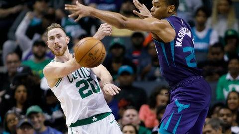 <p>               Boston Celtics' Gordon Hayward (20) gets a pass off against Charlotte Hornets' P.J. Washington (25) during the second half of an NBA basketball game in Charlotte, N.C., Thursday, Nov. 7, 2019. The Celtics won 108-87. (AP Photo/Bob Leverone)             </p>