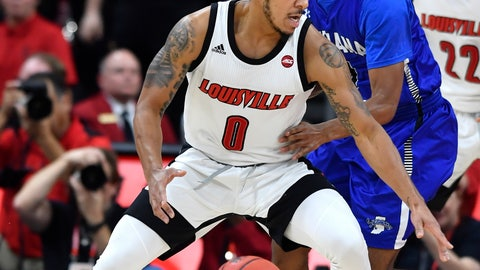 <p>               Louisville guard Lamarr Kimble (0) attempts to get past the defense of Indiana State guard Cam Bacote during the first half of an NCAA college basketball game in Louisville, Ky., Wednesday, Nov. 13, 2019. (AP Photo/Timothy D. Easley)             </p>