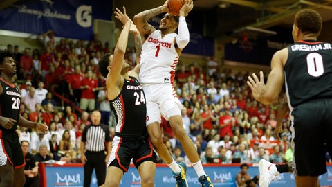 <p>               Dayton forward Obi Toppin (1) goes to the basket over Georgia forward Rodney Howard (24) during the first half of an NCAA college basketball game Monday, Nov. 25, 2019, in Lahaina, Hawaii. (AP Photo/Marco Garcia)             </p>