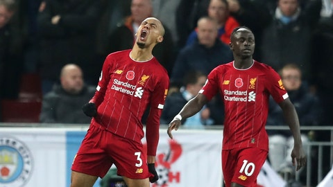 <p>               Liverpool's Fabinho celebrates after scoring his side's opening goal during the English Premier League soccer match between Liverpool and Manchester City at Anfield stadium in Liverpool, England, Sunday, Nov. 10, 2019. (AP Photo/Jon Super)             </p>