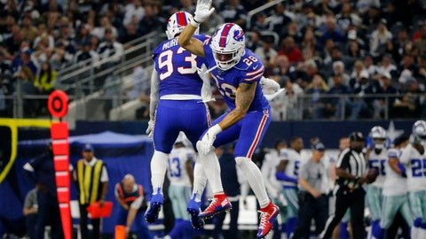 <p>               Buffalo Bills' Trent Murphy (93) and Kurt Coleman (28) celebrate a Dallas Cowboys quarterback Dak Prescott (4) fumble recovered by Murphy in the first half of an NFL football game in Arlington, Texas, Thursday, Nov. 28, 2019. (AP Photo/Michael Ainsworth)             </p>