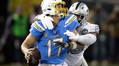 <p>               Los Angeles Chargers quarterback Philip Rivers (17) is sacked by Oakland Raiders defensive end Clelin Ferrell during the second half of an NFL football game in Oakland, Calif., Thursday, Nov. 7, 2019. (AP Photo/Ben Margot)             </p>