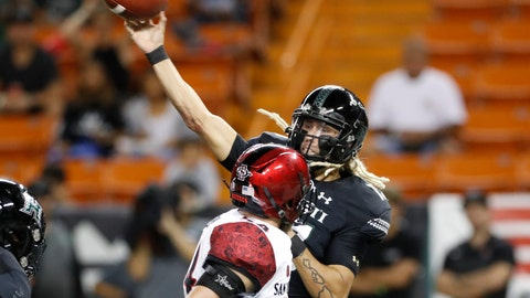 <p>               Hawaii quarterback Cole McDonald (13) throws a pass next to San Diego State linebacker Caden McDonald during the first half of an NCAA college football game Saturday, Nov. 23, 2019, in Honolulu. (AP Photo/Marco Garcia)             </p>