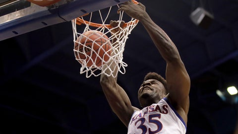 <p>               Kansas center Udoka Azubuike (35) dunks the ball during the first half of an NCAA college basketball game against East Tennessee State Tuesday, Nov. 19, 2019, in Lawrence, Kan. (AP Photo/Charlie Riedel)             </p>