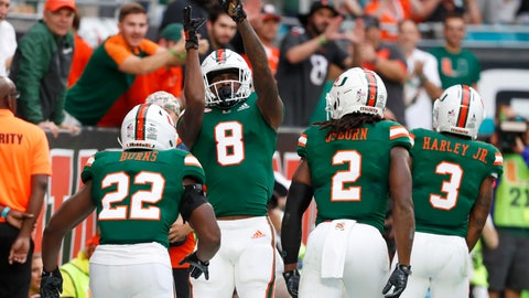 <p>               Miami wide receiver Dee Wiggins (8) celebrates his touchdown as he heads back to the sideline with teammates during the first half of an NCAA college football game against Louisville, Saturday, Nov. 9, 2019, in Miami Gardens, Fla. Others from left, Robert Burns, K.J. Osborn and Mike Harley. (AP Photo/Wilfredo Lee)             </p>