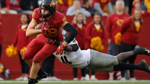 <p>               Iowa State tight end Charlie Kolar, left, runs the ball as Oklahoma State linebacker Amen Ogbongbemiga, right, leaps to make the tackle during the second half of an NCAA college football game, Saturday, Oct. 26, 2019, in Ames, Iowa. Oklahoma State won 34-27. (AP Photo/Matthew Putney)             </p>