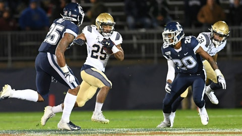 <p>               Navy wide receiver Tazh Maloy (25) gains yardage during the first half of the team's NCAA college football game against Connecticut on Friday, Nov. 1, 2019, in East Hartford, Conn. (AP Photo/Stephen Dunn)             </p>