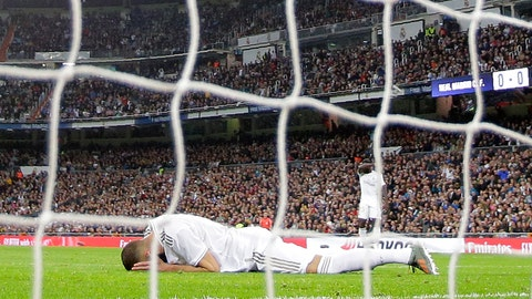 <p>               Real Madrid's Karim Benzema, on the ground, reacts after failing to score during a Spanish La Liga soccer match between Real Madrid and Betis at the Santiago Bernabeu stadium in Madrid, Saturday, Nov. 2, 2019. (AP Photo/Manu Fernandez)             </p>