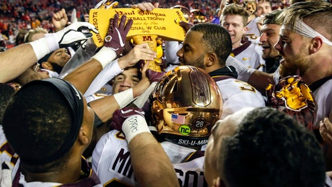 <p>               FILE - In this Nov. 24, 2018, file photo, Minnesota players celebrate with the Paul Bunyan Axe trophy after beating Wisconsin 37-15 in an NCAA college football game, in Madison, Wis. More than Paul Bunyan's Axe is on the line in college football's most-played rivalry. The winner of Saturday's game between No. 9 Minnesota and No. 13 Wisconsin wins a division title, and plays No. 2 Ohio State in the Big Ten title game. (AP Photo/Andy Manis, File)             </p>