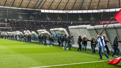 <p>               Fans tear down a symbolic wall on the day of the 30th anniversary of the fall of the Berlin Wall prior the Bundesliga soccer match between Hertha BSC Berlin and RB Leipzig at the stadium in Berlin, Germany, Saturday, Nov. 9, 2019. (Andreas Gora/dpa via AP)             </p>