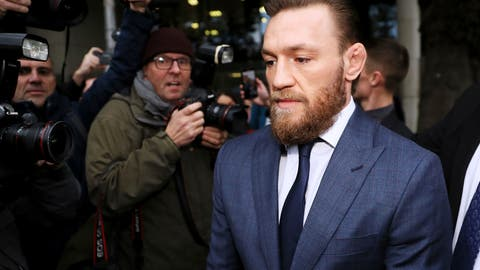 <p>               Conor McGregor leaves Dublin District Court in Dublin, Friday, Nov. 1, 2019. McGregor has been fined $1,120 for assaulting a man in a pub. The retired mixed martial arts fighter from Ireland pleaded guilty to a charge of assault during an appearance at Dublin District Court. The 31-year-old McGregor hasn't fought in MMA since losing by submission to Khabib Nurmagomedov in October 2018. (Brian Lawless/PA via AP)             </p>