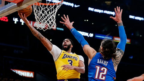 <p>               Los Angeles Lakers' Anthony Davis (3) goes to the basket as Oklahoma City Thunder's Steven Adams (12) dfends during the first half of an NBA basketball game Tuesday, Nov. 19, 2019, in Los Angeles. (AP Photo/Ringo H.W. Chiu)             </p>