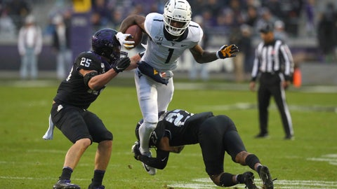 <p>               TCU defensive end Wyatt Harris (25) and safety Ar'Darius Washington (27) try to stop the run by West Virginia wide receiver T.J. Simmons (1) in the first half of an NCAA college football game Friday, Nov. 29, 2019, in Fort Worth, Texas. (AP Photo/Richard W. Rodriguez)             </p>