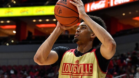 <p>               FILE - In this Oct. 12, 2019, file photo, Louisville forward Jordan Nwora warms up before the start of an NCAA college basketball practice in Louisville, Ky. Louisville is back in the national championship conversation after the basketball program was knocked on its heels amid the fallout of embarrassing scandals, including the school's missteps that were discovered in a federal investigation into college basketball and escorts performing in players' dorm. (AP Photo/Timothy D. Easley, File)             </p>