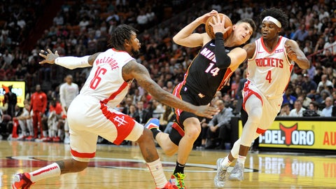 <p>               Miami Heat guard Tyler Herro (14) drives to the net against Houston Rockets guard Ben McLemore (16) and forward Danuel House Jr. (4) during the first half of an NBA basketball game, Sunday, Nov. 3, 2019, in Miami. (AP Photo/Gaston De Cardenas)             </p>