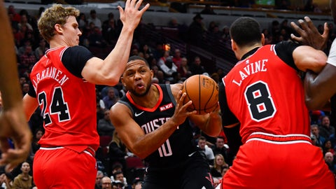 <p>               Houston Rockets guard Eric Gordon (10) drives to the basket between Chicago Bulls forward Lauri Markkanen (24) and guard Zach LaVine (8) during the first half of an NBA basketball game Saturday Nov. 9, 2019, in Chicago. (AP Photo/Matt Marton)             </p>