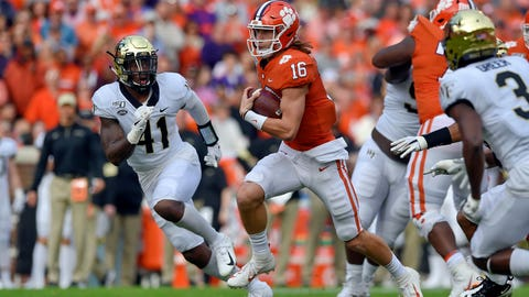 <p>               Clemson quarterback Trevor Lawrence (16) scrambles out of the pocket while defended by Wake Forest's Ja'Corey Johns (41) Clemson's during the first half of an NCAA college football game Saturday, Nov. 16, 2019, in Clemson, S.C. (AP Photo/Richard Shiro)             </p>