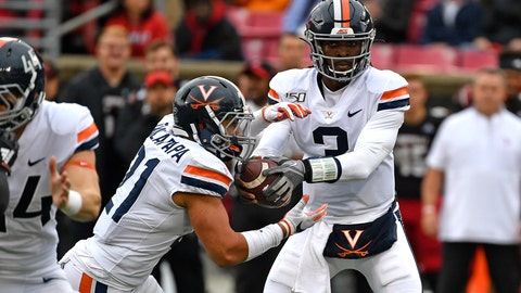 <p>               Virginia quarterback Bryce Perkins (3) makes a handoff to running back Wayne Taulapapa (21) during the first half of an NCAA college football game in Louisville, Ky., Saturday, Oct. 26, 2019. (AP Photo/Timothy D. Easley)             </p>