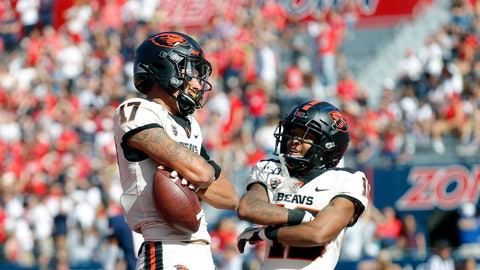 <p>               Oregon State wide receiver Isaiah Hodgins (17) celebrates with Champ Flemings (16) after scoring a touchdown in the first half during an NCAA college football game against Arizona, Saturday, Nov. 2, 2019, in Tucson, Ariz. (AP Photo/Rick Scuteri)             </p>