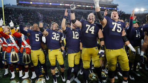 <p>               Members of the Notre Dame football team sing at the end of an NCAA college football game against Virginia Tech, Saturday, Nov. 2, 2019, in South Bend, Ind. Notre Dame won 21-20. (AP Photo/Carlos Osorio)             </p>