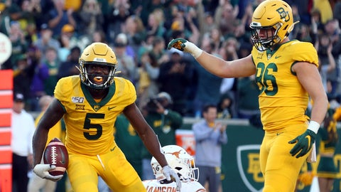 <p>               Baylor wide receiver Denzel Mims (5) and tight end Ben Sims (86) celebrate a third-quarter touchdown against Texas in an NCAA college football game Saturday, Nov. 23, 2019, in Waco, Texas. (AP Photo/Richard W. Rodriguez)             </p>