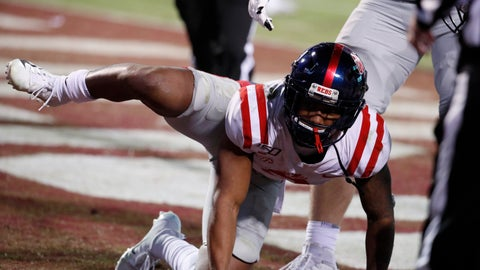 <p>               Mississippi wide receiver Elijah Moore (8) reacts following a touchdown by his team against Mississippi State during the second half of an NCAA college football game in Starkville, Miss., Thursday, Nov. 28, 2019. The act resulted in a 15-yard penalty assessed on the extra point that was missed. (AP Photo/Rogelio V. Solis)             </p>
