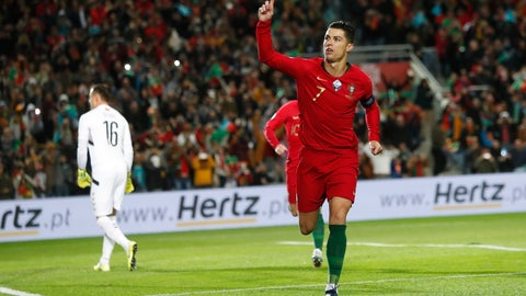 <p>               Portugal's Cristiano Ronaldo celebrates after scoring the opening goal during the Euro 2020 group B qualifying soccer match between Portugal and Lithuania at the Algarve stadium outside Faro, Portugal, Thursday, Nov. 14, 2019. (AP Photo/Armando Franca)             </p>