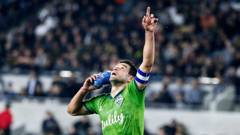 <p>               Seattle Sounders midfielder Nicolas Lodeiro celebrates his goal while holding his shoe during the first half of the team's MLS soccer Western Conference final against Los Angeles FC, Tuesday, Oct. 29, 2019, in Los Angeles. (AP Photo/Ringo H.W. Chiu)             </p>