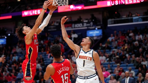 <p>               Denver Nuggets forward Michael Porter Jr. (1) reaches for the ball under the basket, next to New Orleans Pelicans center Jaxson Hayes and guard Frank Jackson (15) during the first half of an NBA basketball game in New Orleans, Thursday, Oct. 31, 2019. (AP Photo/Gerald Herbert)             </p>
