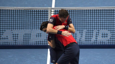 <p>               Pierre-Hugues Herbert of France, front left, and Nicholas Mahut of France celebrate after defeating Raven Klaasen of South Africa and Michael Venus of New Zealand following their ATP World Finals final doubles tennis match at the O2 arena in London, Sunday, Nov. 17, 2019. (AP Photo/Alberto Pezzali)             </p>