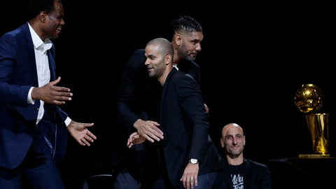 <p>               Former San Antonio Spurs guard Tony Parker, front center, is congratulated by former teammates, from left, David Robinson, Tim Duncan and Manu Ginobili, seated, during Parker's retirement ceremony after the team's NBA basketball game against the Memphis Grizzlies in San Antonio, Monday, Nov. 11, 2019. (AP Photo/Eric Gay)             </p>