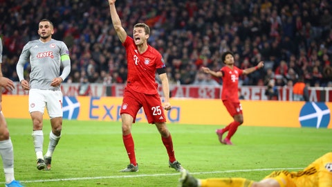 <p>               Bayern's Thomas Mueller, center, celebrates the opening goal of his team during the Champions League group B soccer match between Bayern Munich and Olympiakos in Munich, Germany, Wednesday, Nov. 6, 2019. (AP Photo/Matthias Schrader)             </p>