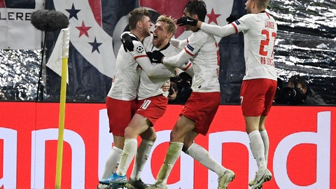 <p>               Leipzig's Emil Forsberg, second from left, celebrates with teammates after scoring his side's second goal during the Champions League group G soccer match between RB Leipzig and Benfica in Leipzig, Germany, Wednesday, Nov. 27, 2019. (AP Photo/Jens Meyer)             </p>