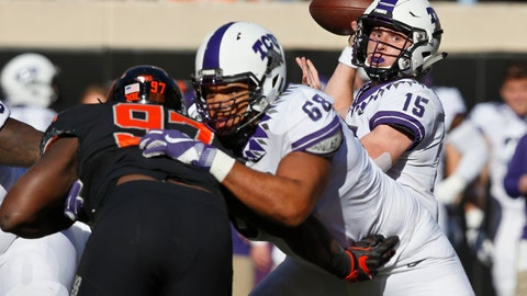 <p>               TCU quarterback Max Duggan (15) passes as offensive tackle Anthony McKinney (68) blocks Oklahoma State defensive tackle Amadou Fofana (97) in the first half of an NCAA college football game in Stillwater, Okla., Saturday, Nov. 2, 2019. (AP Photo/Sue Ogrocki)             </p>