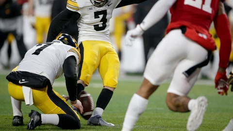 <p>               Iowa kicker Keith Duncan (3) kicks the winning field goal with punter Colten Rastetter (7) holding during the second half of an NCAA college football game against Nebraska in Lincoln, Neb., Friday, Nov. 29, 2019. Iowa won 27-24. (AP Photo/Nati Harnik)             </p>