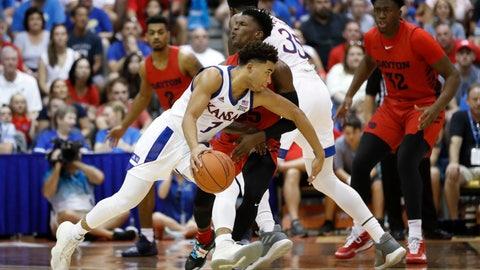 <p>               Kansas guard Devon Dotson (1) collides Dayton guard Dwayne Cohill during the first half of an NCAA college basketball game Wednesday, Nov. 27, 2019, in Lahaina, Hawaii. (AP Photo/Marco Garcia)             </p>