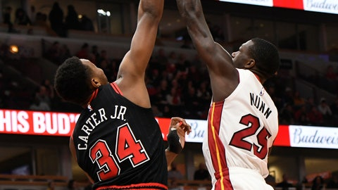 <p>               Miami Heat's Kendrick Nunn (25) goes up for a shot against Chicago Bulls' Wendall Carter Jr. (34) during the first half of an NBA basketball game Friday, Nov. 22, 2019, in Chicago. (AP Photo/Paul Beaty)             </p>