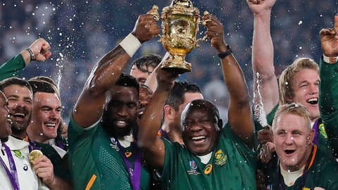 <p>               South African captain Siya Kolisi holds the Webb Ellis Cup aloft with South African President Cyril Ramaphosa after South Africa defeated England to win the Rugby World Cup final at International Yokohama Stadium in Yokohama, Japan, Saturday, Nov. 2, 2019. (AP Photo/Christophe Ena)             </p>