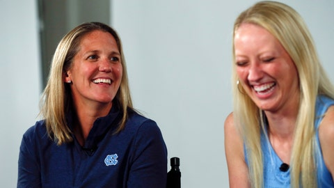 <p>               FILE - In this Oct. 3, 2019, file photo, North Carolina women's basketball coach Courtney Banghart, left, laughs with guard Taylor Koenen during the Atlantic Coast Conference women's NCAA college basketball media day in Charlotte, N.C. Banghart is taking over a North Carolina program in need of an overhaul on and off the court.(AP Photo/Nell Redmond, File)             </p>