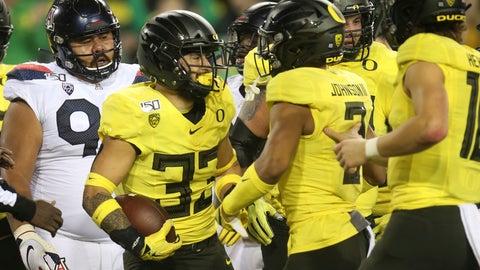 <p>               Oregon's Cyrus Habibi-Likio, center, celebrates his second-quarter touchdown against Arizona during an NCAA college football game Saturday, Nov. 16, 2019, in Eugene, Ore. (AP Photo/Chris Pietsch)             </p>